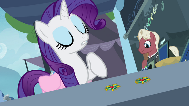 File:Rarity pointing at one of the brooches S4E22.png