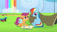 Scootaloo points at pictures of Rainbow's parents S7E7