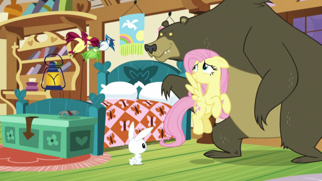 File:Fluttershy smiling at her animal friends S5E21.png