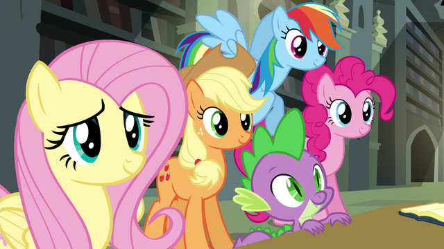File:Twilight's friends smiling at Rarity S4E25.png
