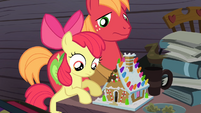 Apple Bloom and Big McIntosh looking at the gingerbread house S4E09