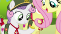 Fluttershy giving a bit to Sweetie Belle S6E15.png