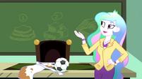 Principal Celestia gestures toward the chalkboard SS8