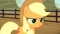 Applejack looking sternly at Braeburn S5E6
