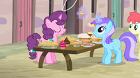 Diamond Mint takes a cupcake from Sugar Belle's table S5E2