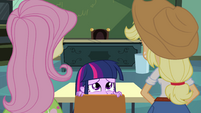 Twilight hides behind chair EG