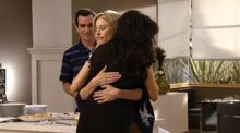Claire and Gloria hug and exclude Phil