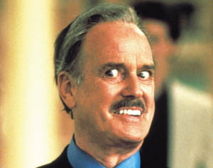 File:Rat Race -John Cleese.jpg