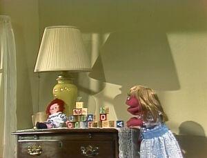 Raggedy Ann doll in Prairie Dawn's room