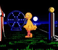 Big Bird dacing in the Letter-Go-Round game