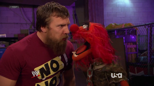 File:WWE-TributeToTheTroops-12-(2012-12-19).png