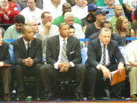 Rivers (center) sits on the sidelines with assistant coaches Tom Thibodeau (right) and Armond Hill (left) in Game 4 of the 2008 NBA Playoffs against the Atlanta Hawks