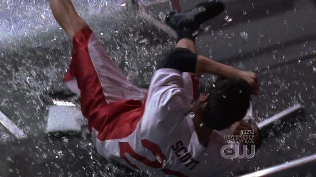 File:609 n is thrown through a glass guard.jpg