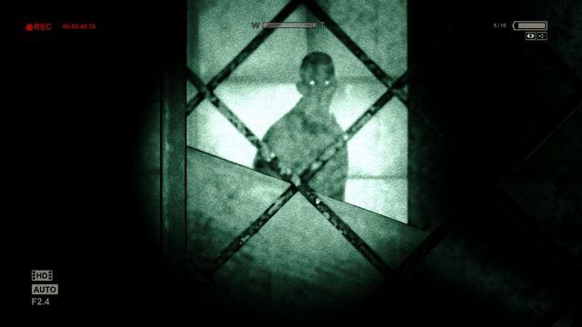 File:Eddie seen behind boarded doors.jpg