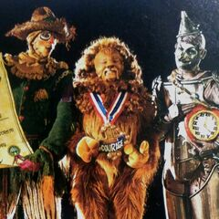 <b>Scarecrow, Lion, and Tin Man receiving their gifts from The Wizard</b>