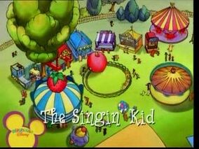 The Singing Kid Title Card