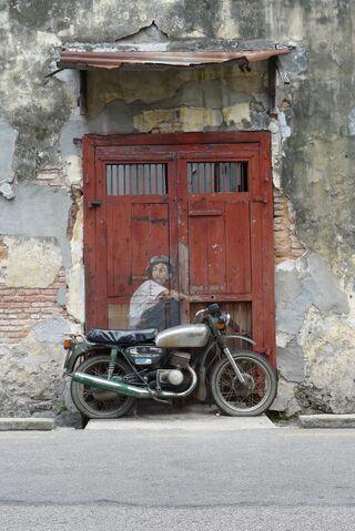 File:Penang - Boy on a Bike.JPG