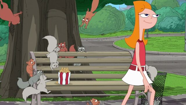 File:Candace leaving the bench and leaves food for the squirrels.jpg