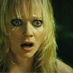 Dakota stares at Rapist #1.