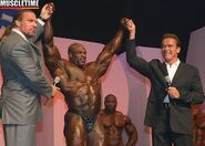 Arnold Schwarzenegger and Triple H at the 2004 Mr Olympia