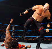 Kane beats down kofi kingston