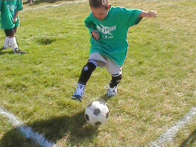 File:Kid playing soccer.jpg