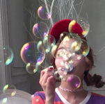 Irene blowing bubbles