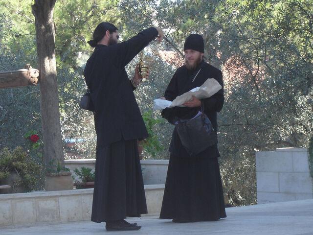 File:2 priests checking merchandise.JPG
