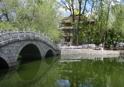 The quiet and peaceful park, pond, and chapel behind the Potala