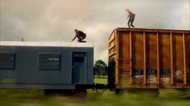 File:Charlie and Miles on top of the train..png