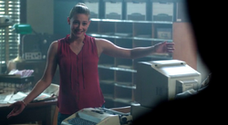 Season 1 Episode 3 Body Double Betty opening the blue and gold