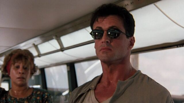 File:Sylvester stallone the specialist sunglasses in bus 5db8a25cd92b01c19c8fe2dd7cbc16ef.jpg