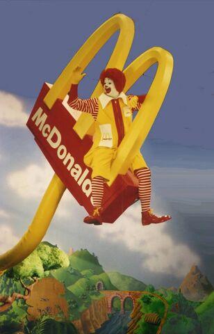 File:Ronald McDonald rides the sign.jpg