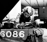 Elizabeth tinkering with a car during WWII