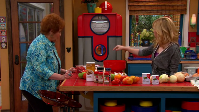 File:Sam showing Nona the meatball ingredients.png
