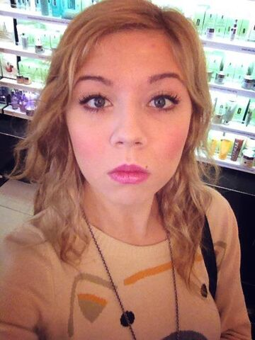 File:Jennette in front of cosmetics.jpg