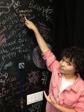 Cameron pointing to his name on the Fanlala wall