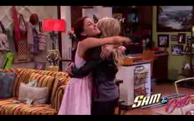 File:Cat hugging Sam in first promo.png