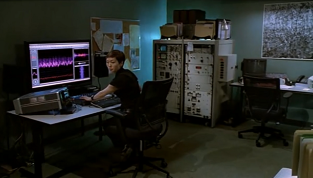 File:Sachi looks at Erickson, Perez and Hoffman as they enter the lab.png