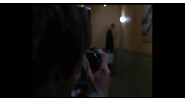 File:Adam photographed Gordon in front of Carla's hotel room door.png
