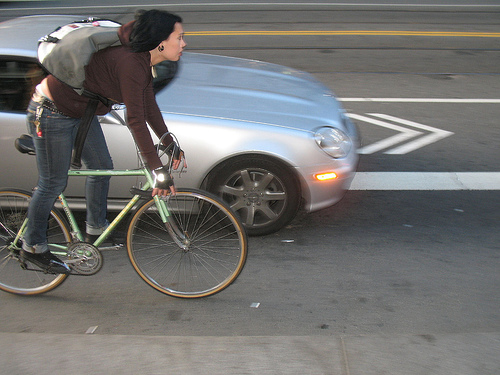 File:Market Street cyclist getting the squeeze.jpg