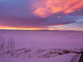 Wyo snow at sunset