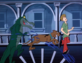 Gator Ghoul chases Scoob and Shag on paddle wheel.png