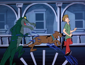 Gator Ghoul chases Scoob and Shag on paddle wheel