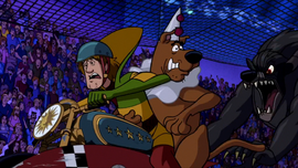 Shag and Scoob ride away from circus werewolf