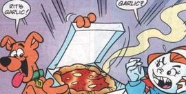 Scoob offers pizza to Vampire Daphne