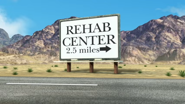 File:Father of the Pride Rehab Center Sign.png