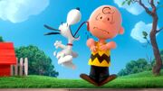 Snoopy licking Charlie Brown