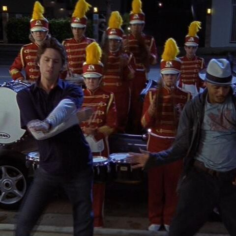 Turk is escorted to the hospital by a marching band