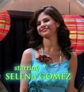 Selena wearing a blue dress
